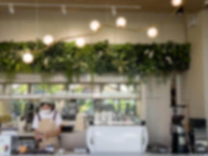 Defocused image of illuminated restaurant