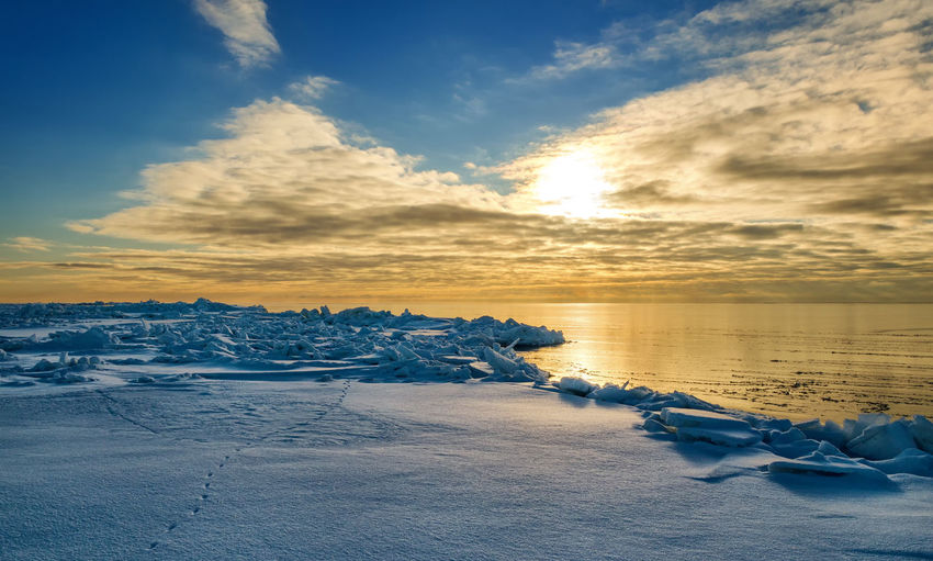 Sky Winter Cold Temperature Snow Beauty In Nature Cloud - Sky Scenics - Nature Tranquil Scene Sunset Tranquility Nature Environment Water Frozen Non-urban Scene Idyllic Landscape Land Ice No People Iceberg
