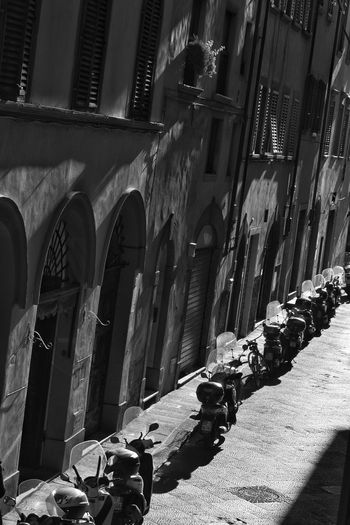 Florence Street By Day Door Doorways Shadows & Lights Shadow Street Street Photography Black And White Monochrome Parking Mopeds Vespas Windows Shutters Angular Casting A Shadow Afternoon Sunlight Day Architecture No People Indoors  Built Structure