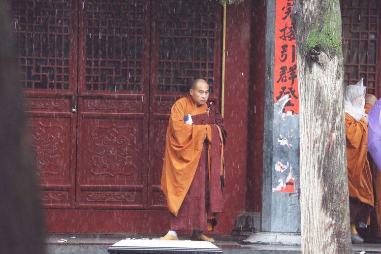 Portrait of buddha statue against door