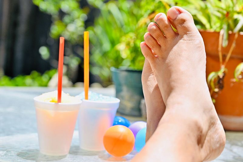 A relaxing moment with snow cones from the sidewalk vendors. Asian  Feet Toes Table Foam Cups Paper Cup EyeEm Selects Refreshment Human Body Part One Person Food And Drink Drink Drinking Straw Food Relaxation Straw Body Part Indulgence Close-up Focus On Foreground Lifestyles Freshness Day Real People Adult Glass Outdoors