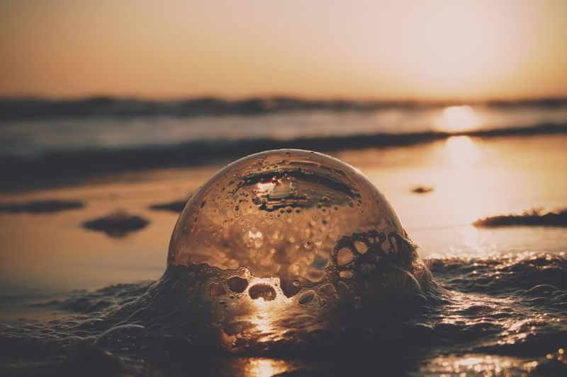 Close-up of sea water during sunset