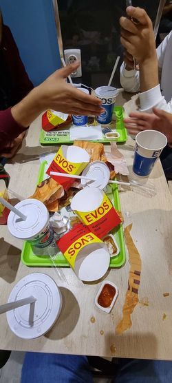 High angle view of people holding food on table