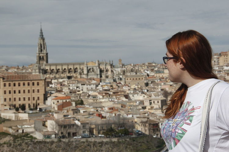 Tourist Against Toledo Cityscape