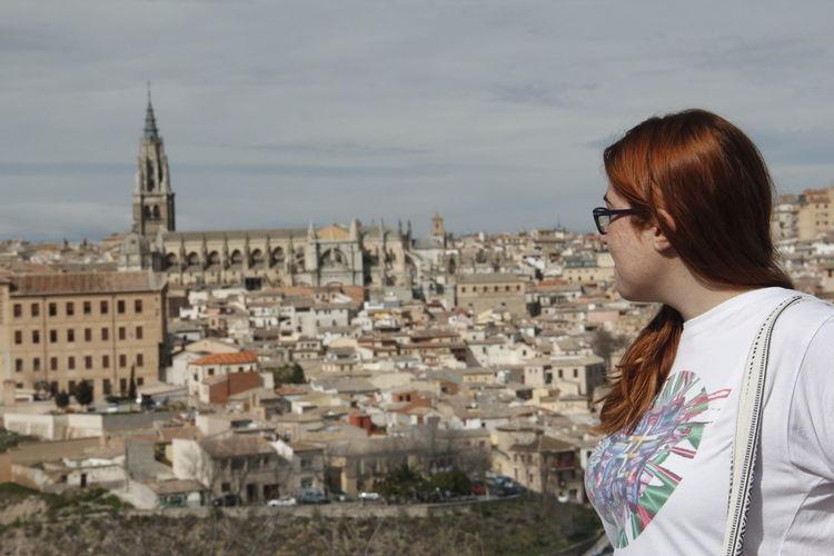 Tourist against toledo cityscape