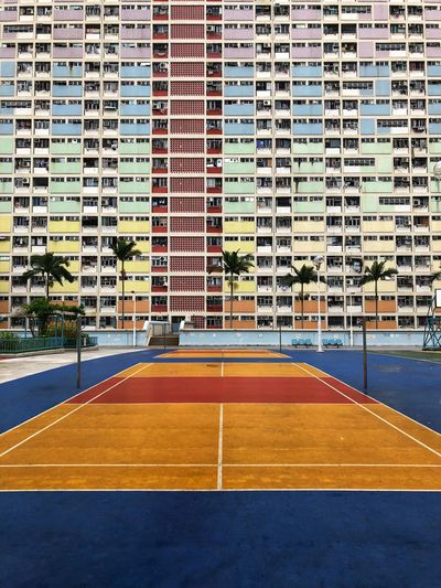 Soccer court against buildings in city