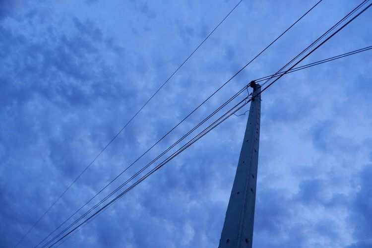 Low Angle View Cloud - Sky Sky Cable Electricity  Technology Connection No People Power Line  Power Supply Electricity Pylon Blue Outdoors