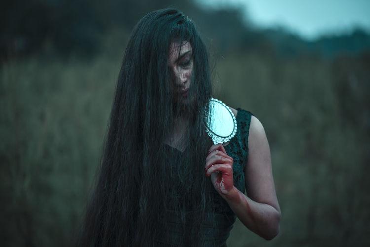 Portrait of a beautiful young woman wearing mask