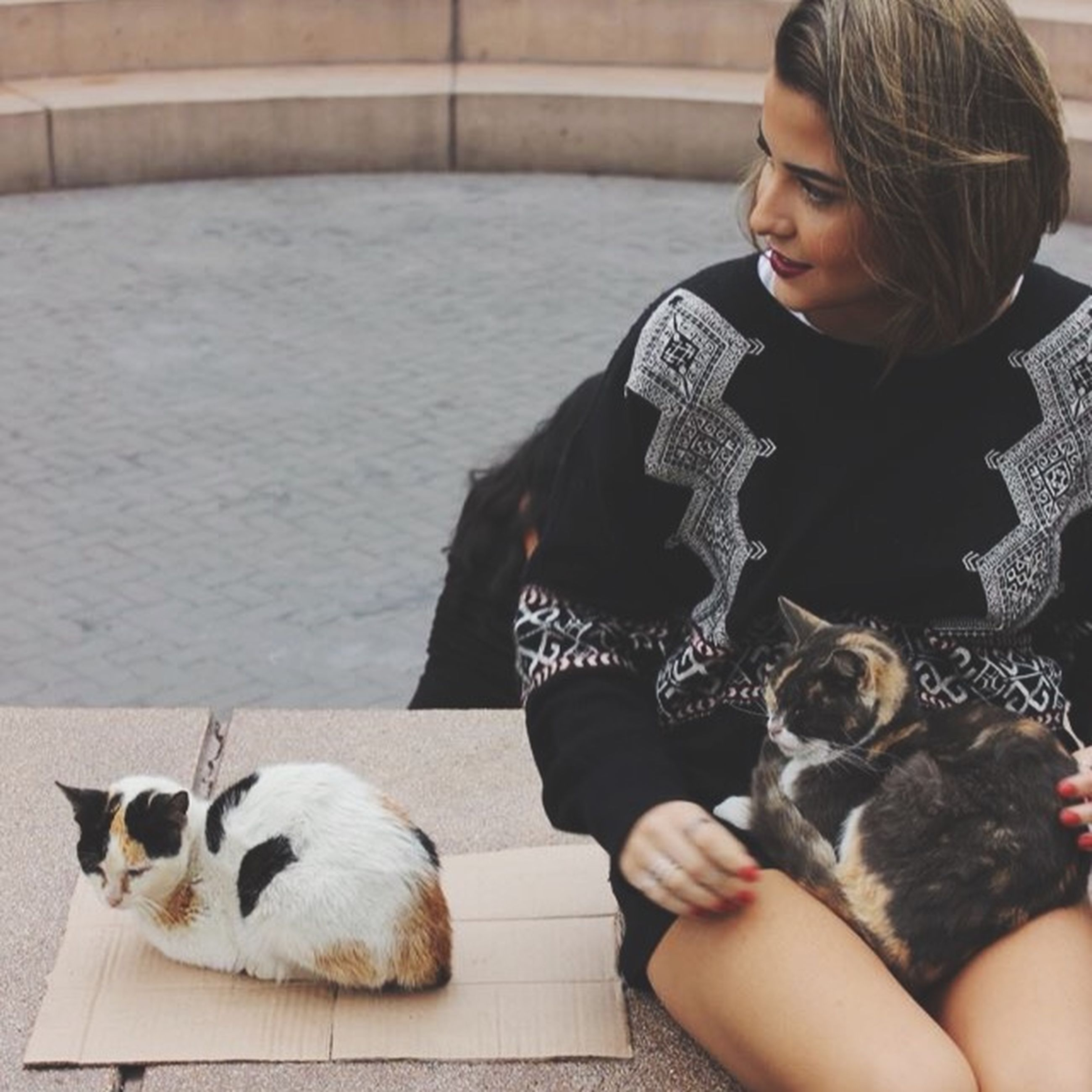 pets, domestic animals, animal themes, mammal, one animal, lifestyles, dog, leisure activity, person, sitting, relaxation, pet owner, lying down, casual clothing, domestic cat, childhood, togetherness, full length