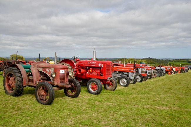 Historic tractors Cornish History Cornwall Country Show Vintage Show Line Of Tractors Vintage Tractors Cloud - Sky Transportation Sky Land Vehicle Grass Agricultural Machinery Plant Agricultural Equipment Agriculture No People Landscape Rural Scene Land Tractor