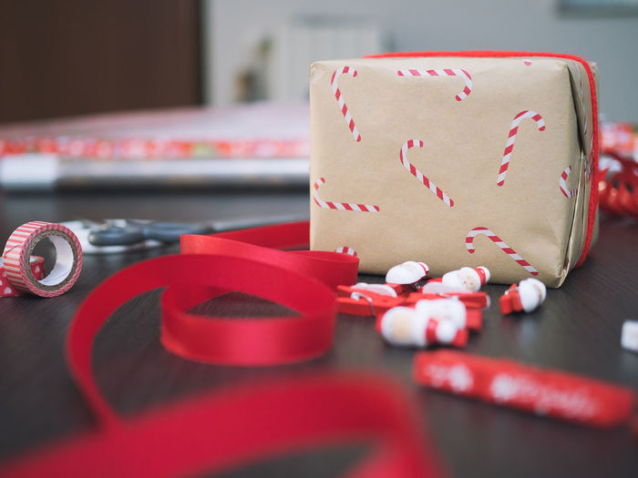 Close-up of christmas decoration with gift on table