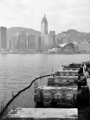 Architecture Building Exterior Built Structure City Light And Shadow IPhoneography @moment Cloud - Sky Landscapes Moment Lens Smoggy Sky Victoria Harbour Waterfront Black And White Black & White Urban Landscape Urban Skyline Hong Kong Skyline Outdoors Cityscape Sky Sea Nautical Vessel Skyscraper