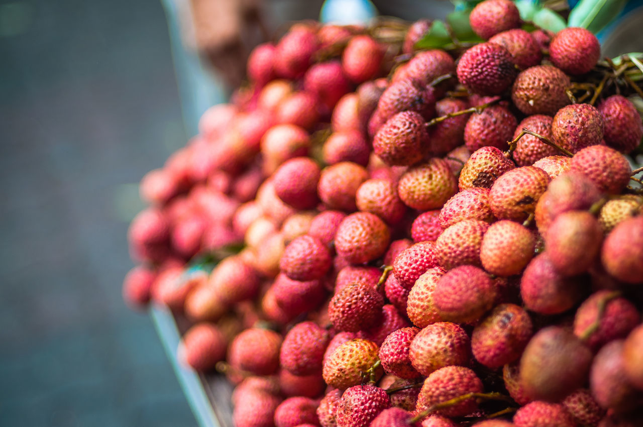 High Angle View Of Lychees For Sale At Market Stall