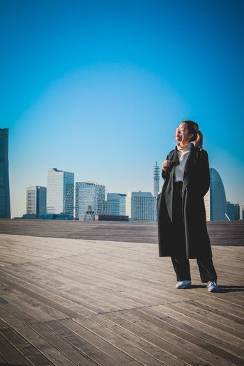 Yokohama Skyline on a warm sunny winter day. Canon 70D First Eyeem Photo Model Fashion Japanese Culture Yokohama, Japan Yokohama Japan Travel Japan Lovers Japan Japanexplorer Winter Season Full Length Architecture Real People Sky City Leisure Activity One Person Building Exterior Built Structure Day Young Adult Lifestyles Communication Outdoors Standing