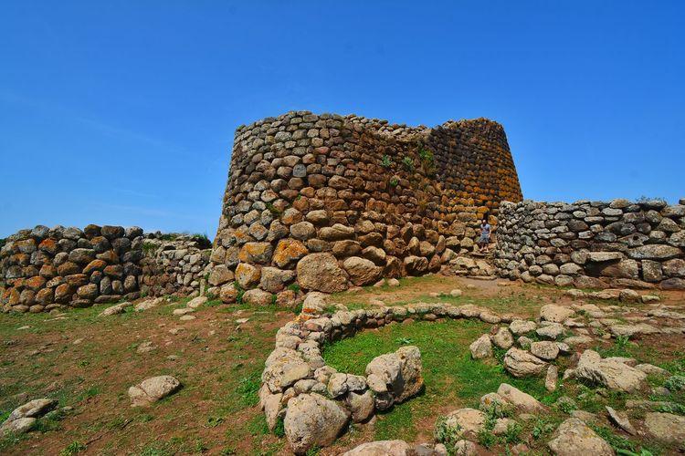 Stone wall against blue sky