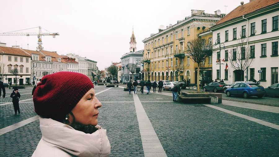 Streetphotography Woman Buildings Architecture Bricks Footpath City City Life Cityscape Outdoors Winter 2016 Lithuania Vilnius