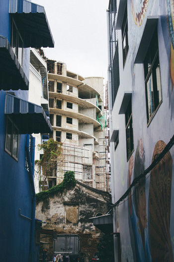 Low angle view of buildings in town against sky