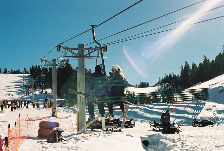 People Enjoying At Angel Fire Resort Against Sky During Sunny Day