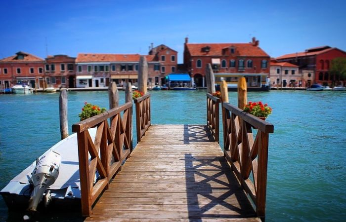 """We take photos as a return ticket to a moment otherwise gone."" ~Anonymous. Photo taken on Murano Island,Venice,Italy. What I Value Wanderlust Traveling Edge Of The World Travel Photography Bridge River Boats Travel EyeEm Best Shots"
