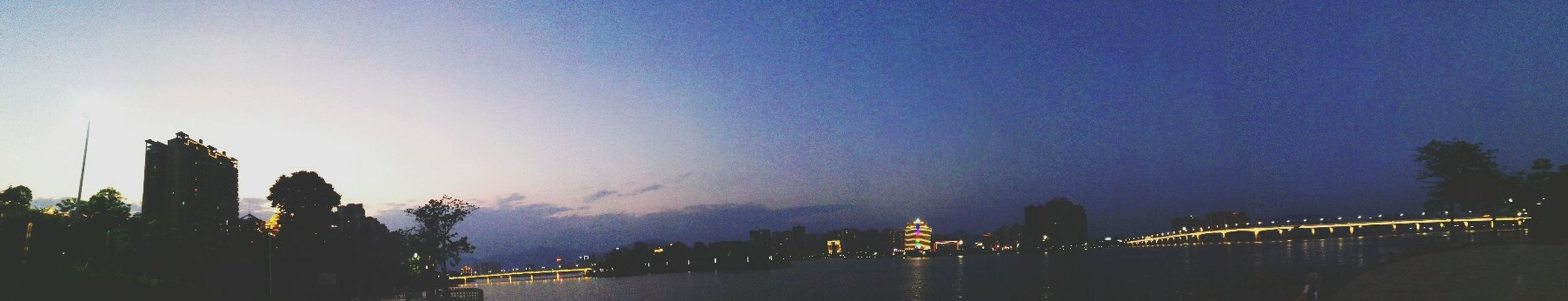 Outdoors Sky City Life River Dusk Built Structure City Water Connection Architecture Built Structure Bridge - Man Made Structure Connection Water Building Exterior River Illuminated Dusk City Panoramic Waterfront Travel Destinations Engineering Bridge City Life First Eyeem Photo