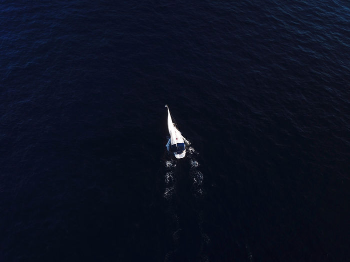 Aerial view of a sailing boat at sea