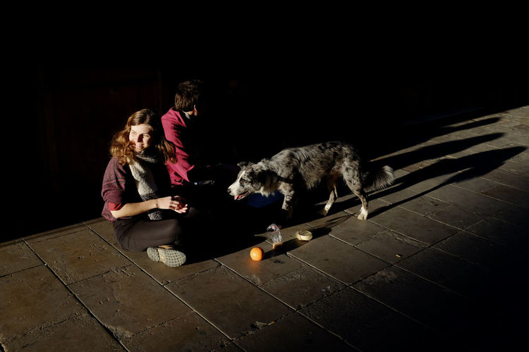 Woman with dog in the dark
