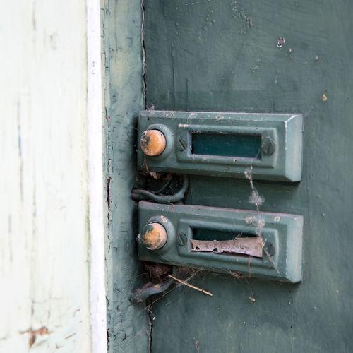 Close-up of old rusty metal door