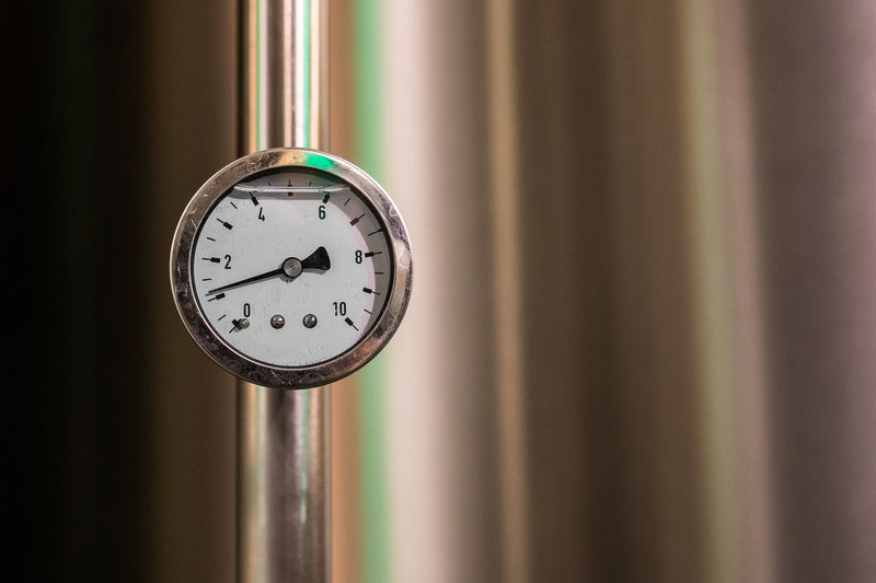 Close-up of gauge on pipe
