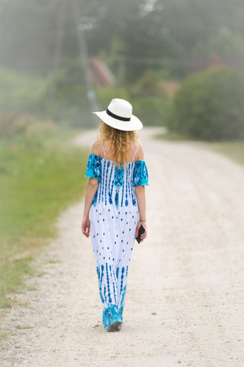 Rear view of a woman walking outdoors