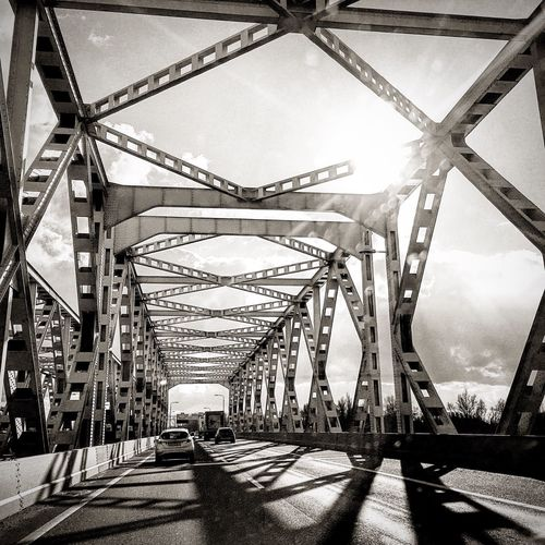 Transportation Connection Bridge - Man Made Structure Built Structure Architecture Road Auto Post Production Filter The Way Forward Sky Engineering Mode Of Transport Urban Urban Geometry No People Urbanphotography Road Grid Day Long Sunny Outdoors Suspension Bridge Iron - Metal Surface Level Tall - High