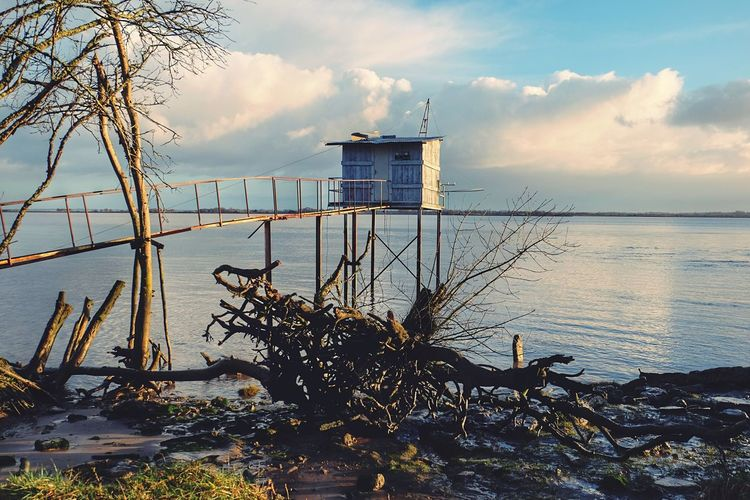 Still there Water Sea Built Structure Architecture Tranquility Sky Nature Beauty In Nature No People Scenics Horizon Over Water Cloud - Sky Outdoors Tranquil Scene Day Building Exterior Tree Lifeguard Hut Exceptional Photographs EyeEm Nature Lover EyeEm Best Shots Architectural Detail