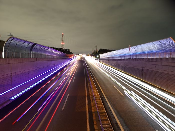 High angle view of light trails on highway at night