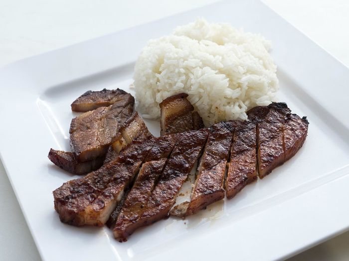 High angle view of barbecue pork and rice on plate