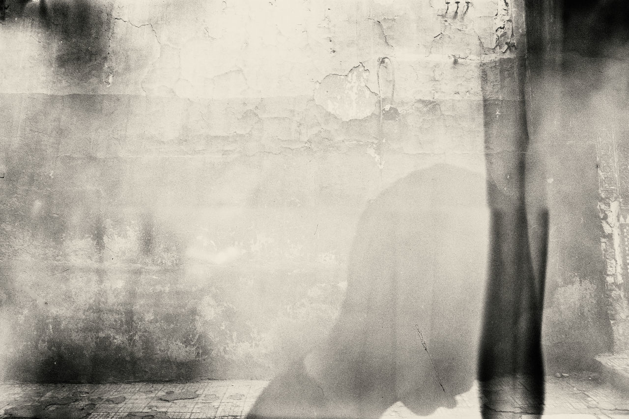 architecture, built structure, wall - building feature, one person, real people, window, day, indoors, wall, digital composite, women, glass - material, multiple exposure, lifestyles, adult, old, building, transparent, contemplation, textured effect