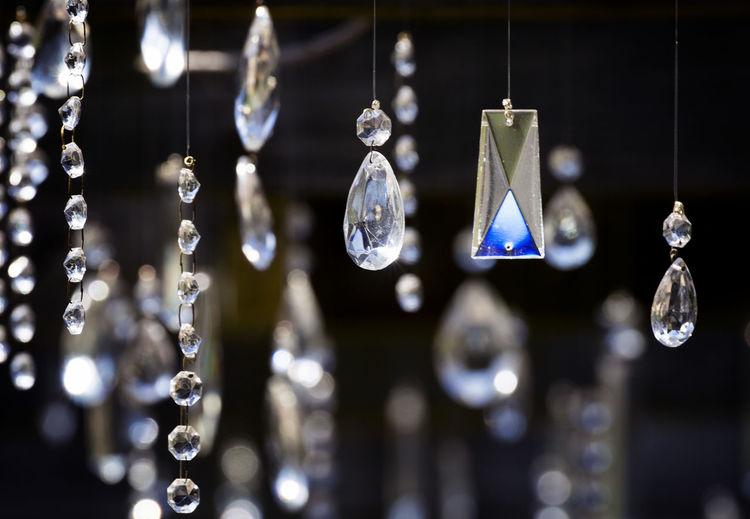 Close-up of chandelier hanging at shop