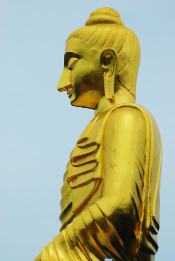Art And Craft Clear Sky Close-up Creativity Day Gold Colored Golden Color Human Representation Low Angle View Male Likeness No People Outdoors Sculpture Sky Spirituality Statue Yellow