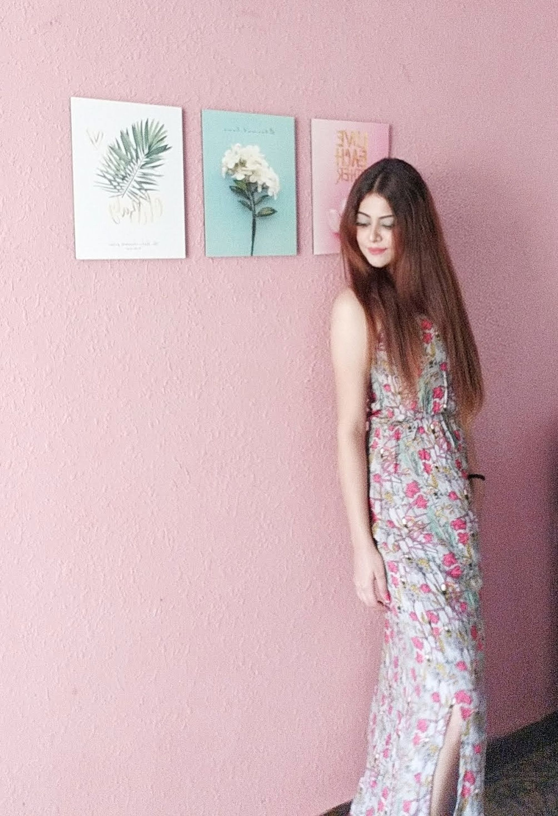 standing, one person, long hair, hairstyle, wall - building feature, three quarter length, young adult, hair, lifestyles, casual clothing, young women, portrait, looking at camera, women, real people, leisure activity, fashion, beautiful woman, black hair, floral pattern, contemplation
