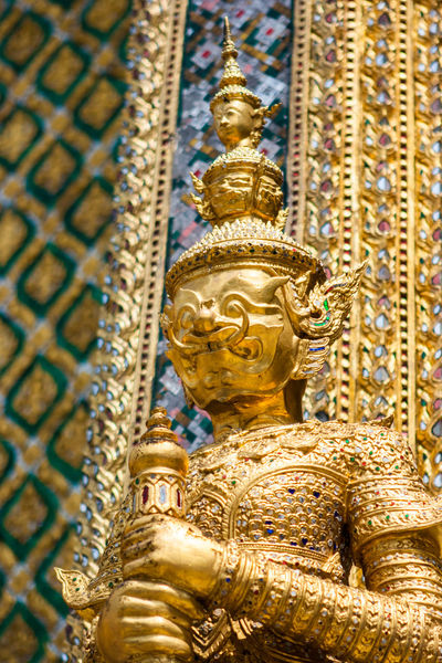 Portrait of a golden statue at the Wat Phra Kaew Palace, also known as the Emerald Buddha Temple. Bangkok, Thailand. Architecture Bangkok Emerald Buddha Temple Thai Thailand Wat Phra Kaew Architecture Art And Craft Belief Buddhism Built Structure Gold Gold Colored Human Representation Landmark No People Phra Sri Rattana Place Of Worship Religion Royal Palace Sculpture Spirituality Statue Travel Destinations