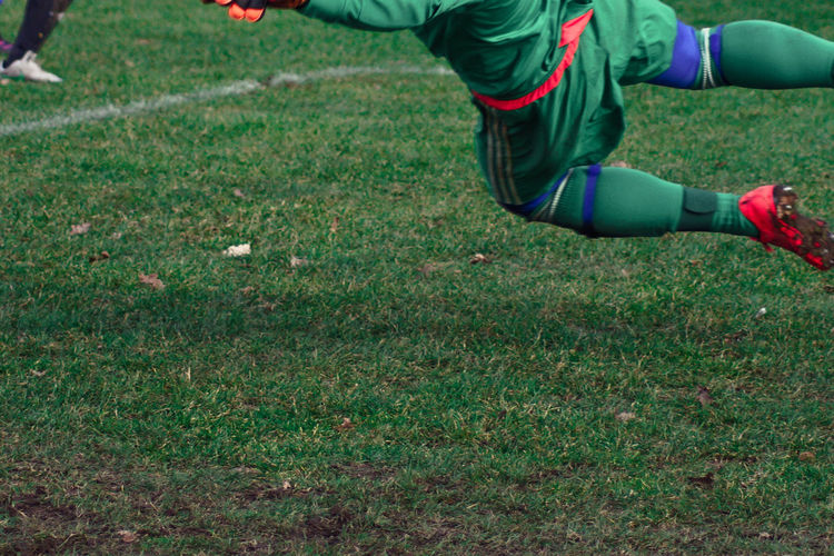 Low Section Of Soccer Player Playing On Field