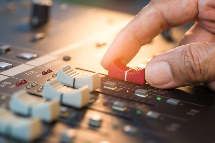 Sound balancing concert. Adjusting Balancing Concert Digital Mixer Human Hand Lighting Decoration Live Music Loudness PA System Sound Recording Equipment