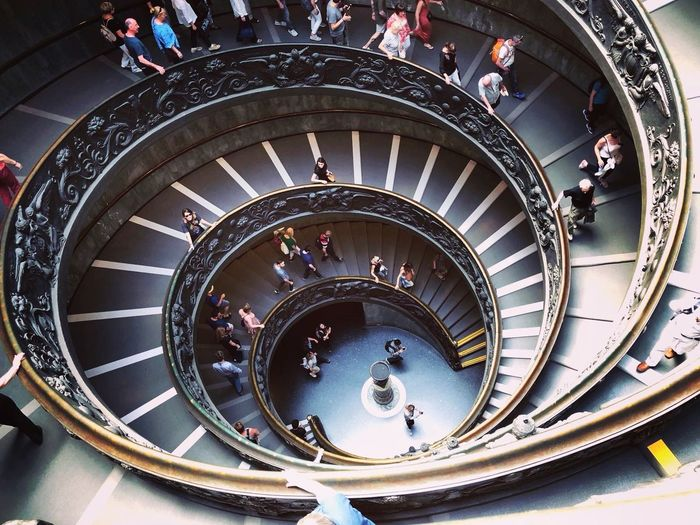 City Spiral Staircase Steps And Staircases Spiral Directly Above Steps High Angle View Staircase Railing Architecture