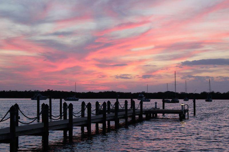 Pier On Lake Against Sky