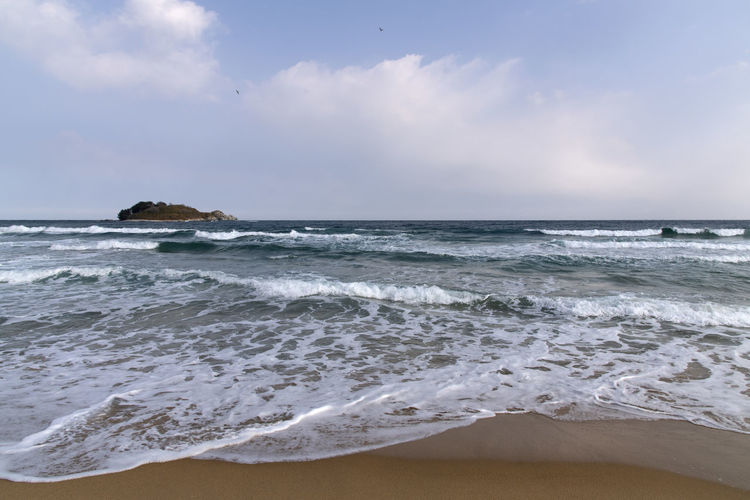 Hwajinpo Beach in Goseong, Gangwondo, South Korea Beach Land Water Beauty In Nature Outdoors Hwajinpo Beach Winter Beach Winter Sea Tranquil Scene Naturelovers Natur's Beauty Sea Wave Motion Sky Horizon Over Water Aquatic Sport Horizon Surfing Scenics - Nature Sport Cloud - Sky Nature Sand Day