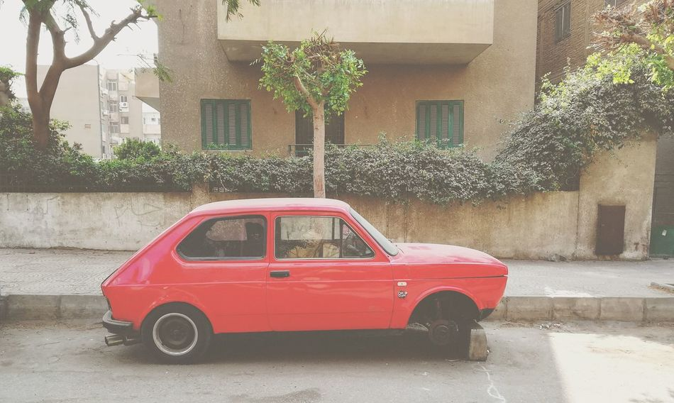 Red Architecture Building Exterior Built Structure Outdoors Day No People Water Tree Car Egypt Outdoors❤ Fiat Nowheels Street City Old Car