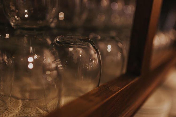 Close-up of glasses arranged in shelf