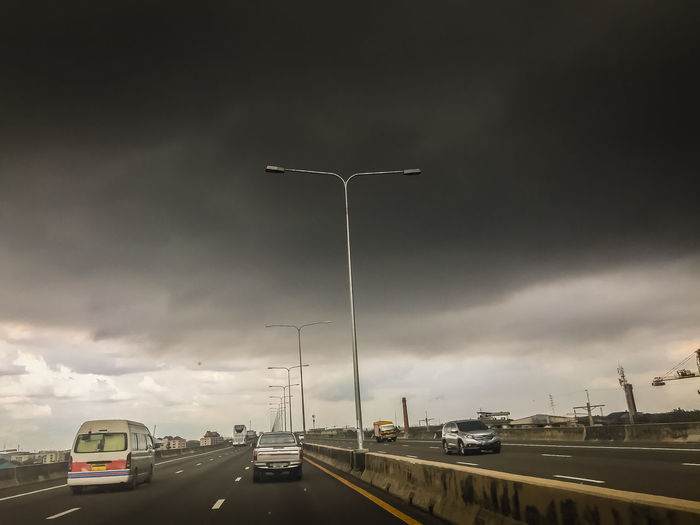 Expressway with dramatic overcast sky and black cloud before rainy. Black Cloudy Sky Dramatic Sky Stormy Clouds Stormy Weather Black Cloud Black Clouds Black Clouds Coming Car City Cloud - Sky Direction Express Way Expressway Expressway Bridge Highway Land Vehicle Lighting Equipment Mode Of Transportation Motion Motor Vehicle Nature No People on the move Outdoors Overcast Overcast But Beautiful Overcast Day Overcast Morning Overcast Skies Overcast Sky Overcast Sky Overcast Overcast Sunrise Overcast Weather Overcast Weather ❤ Overcastbutbeautiful Overcastsky Overcastweather Road Sky Stormy Sky Street Street Light The Way Forward Transportation Travel