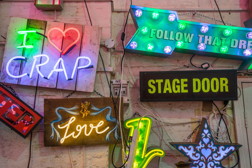 Neon signs and decorations at God's Own Junkyard in Walthamstow, London. Bright Colors Colourful Low Angle View Neon Signs Stage Door City Lighting Communication Crap Multi Colored Neon Neon Lights Text Urban Urban Lighting