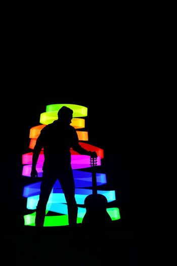 Rear view of silhouette man standing at night