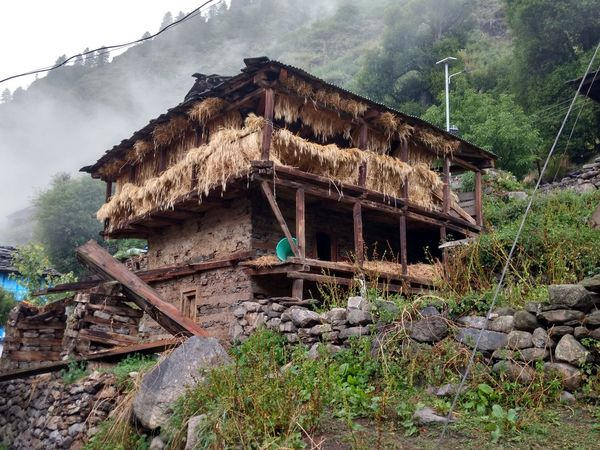 home of rural Himalayan village Rural Safe The Grass For Next Winter Session Home Mountain Slop Village Roof Tree House Sky Architecture Building Exterior Built Structure Hut