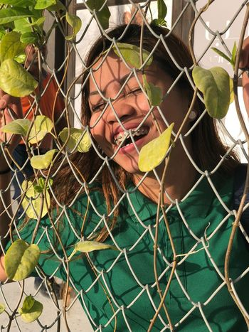 I am happy that I captured the genuine laugh she made after the thunderstorm she had in her life. One Person Fence Real People Leisure Activity Lifestyles Young Adult The Portraitist - 2018 EyeEm Awards Chainlink Fence Front View Portrait Barrier Women Boundary Day Nature Outdoors